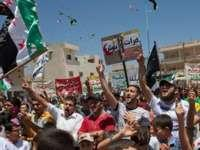 Anti-government protesters chant in the northern Syrian city of Idlib